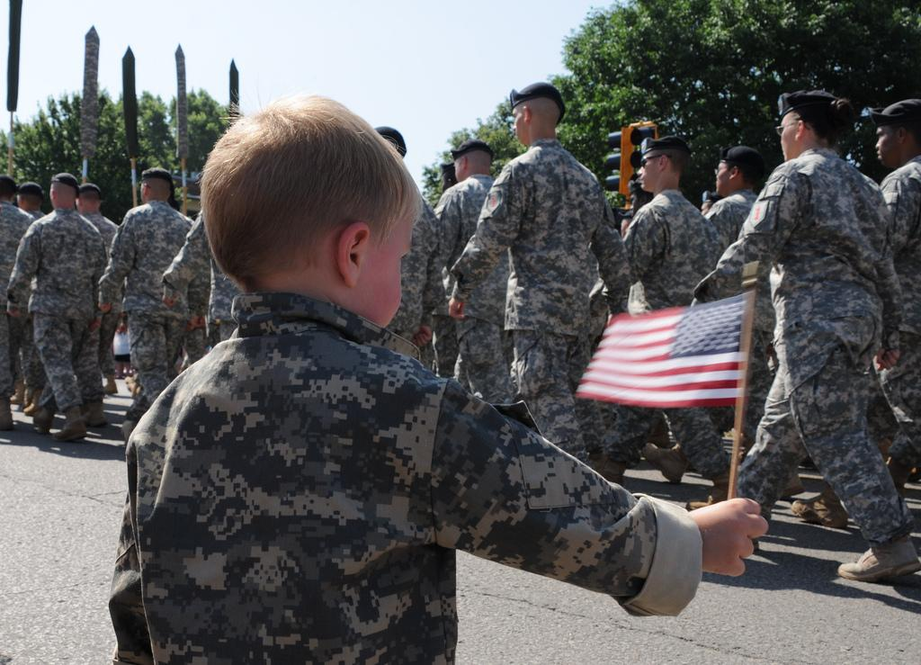 A soldiers child at a parade