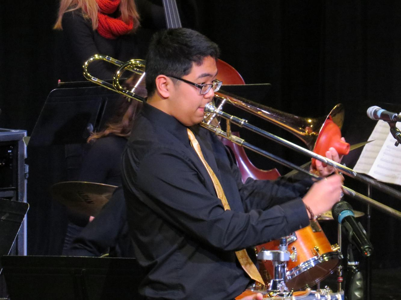 Kenan Lumantas solos on the trombone at a Jazz Ensemble Concert.