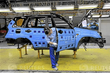 Employee of Chery Automobile Co. works at the assembly line in Wuhu