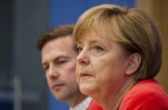 Angela Merkel e o seu porta-voz