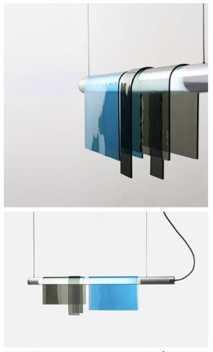 The Photochrome lamps of Jean Couvreur, comprising coloured glass forms hung from suspended fluorescent tubes found on pinterest.com