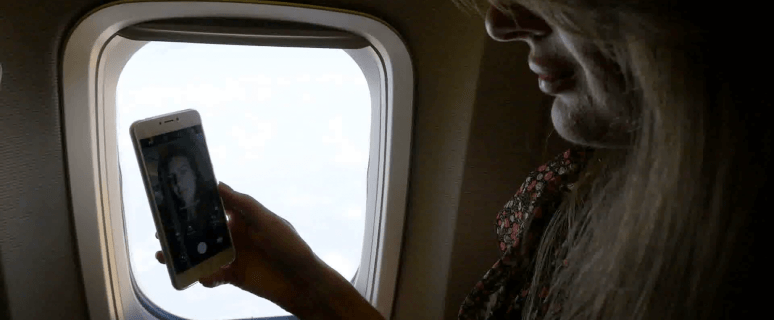 Survey: Travelers becoming less social on planes 5