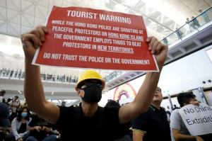 Airline passengers panic as protesters besiege Hong Kong airport