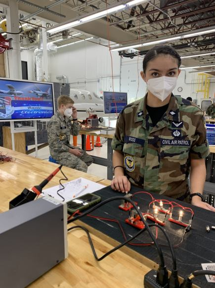 Female and male cadets from the North Carolina Wing of the Civil Air Patrol (CAP) at STEM Workshop at Aviation Institute of Maintenance in Charlotte.