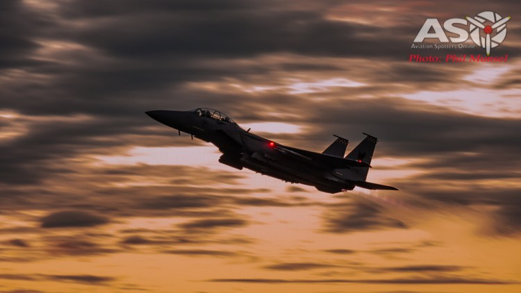 Full Afterburners lit, as the crew in their F-15SG take to the vibrant copper sky