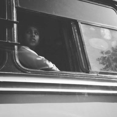Forlorn face in a Delhi bus window