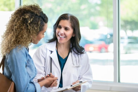female doctor speaking to female patient in doctor's office
