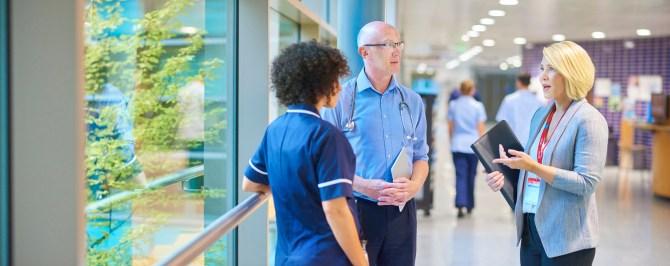 new healthcare job with doctors speaking in hallway