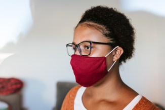woman-in-profile-wearing-red-hypoallergenic-mask-during-coronavirus-pandemic
