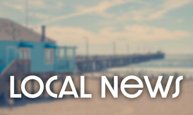 Artist Colleen Gnos Installs Replacement Lifeguard Tower Mural