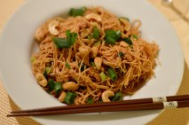 Asian noodles with soy meat, spring onions and cashews