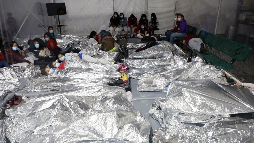 Children wrapped up like burritos in cages at the Donna, Texas DHS facility