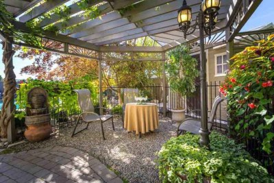 The Shaded Gazebo Welcomes Guests as They Make Their Way Down the Garden Path at A Vista Villa Couples Retreat in Kelowna, BC