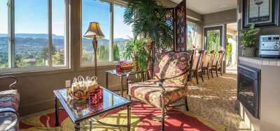 VIP Guests Can Socialize in the  Guest Lounge With Sweeping Views of the  Lake Okanagan and the City of Kelowna at A Vista Villa Couples Retreat