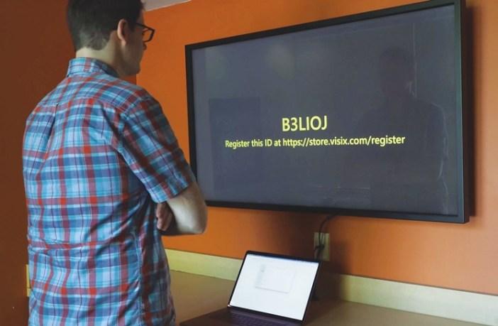 man looking at Visix registration screen