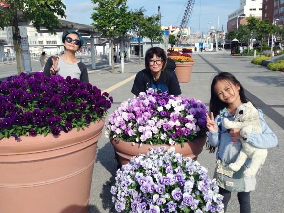 Huge flower pots in front of the station