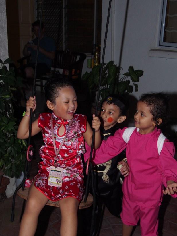 kiddies playing swings