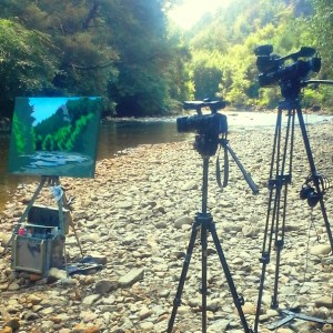 DVD shoot day shows a half painted canvas alongside the Avoca River.