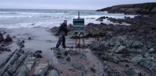 Rod Coyne painting the Kerry coastline up to his ankles in the Atlantic