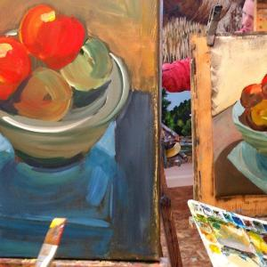Two art students getting creative with apples. September Painting Course.