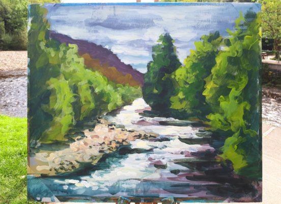 Rod Coyne's mornig painting demo rests on a easel in front of the Avoca River.