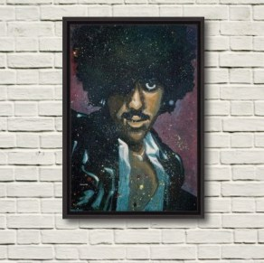 "This photo depicts Rod Coyne's 'Phil ""Philo"" Lynott' canvas print in a black frame. The rustic brick wall gives a sense on the 100x70cm painting size."