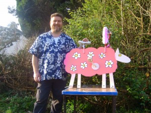 Artist Rod Coyne pictured with his creation Daisy the bicycle sheep.