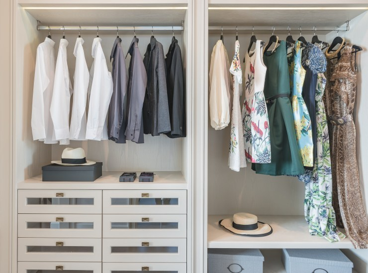 modern and tidy wardrobe interior featuring a selection of men's and women's clothes: after wardrobe edit