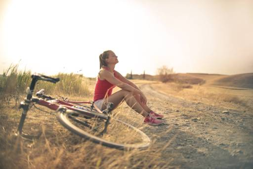 Female cyclist reaping the benefits of increased energy and vitality.