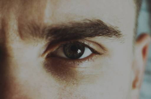 """Close up of the left eye of a man who seems to be asking, """"What happens when the ego becomes overwhelmed?"""