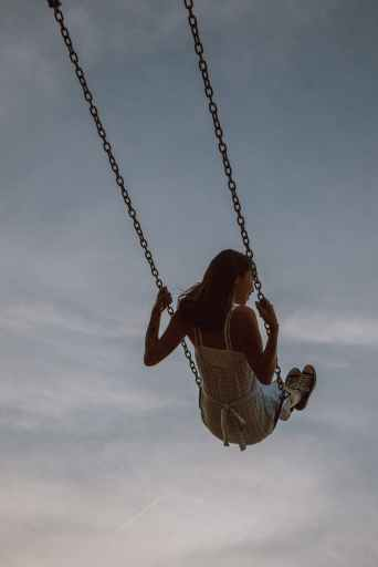 Woman swinging on swing and enjoying the ride because she knows how to get what she wants.