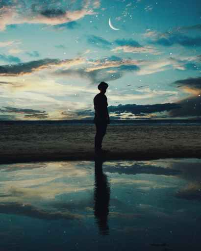 silhouette of man standing near body of water Dreams like these are signs your soulmate is thinking about you.