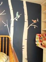 http://www.babylifestyles.com/2012/12/baby-girls-navy-blue-bird-and-tree-themed-antique-nursery-room/