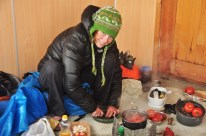 Cooking in an unfinished hut we found at the side of the road, very thankful to have a dry place to cook!