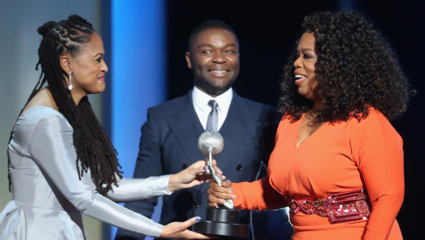 from left; Selma director and producer Ava DuVernay, actor David Oyelowo and producer Oprah Winfrey accept the award for Outstanding Motion Picture for Selma