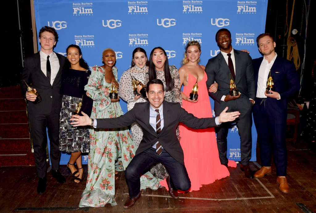 SANTA BARBARA, CALIFORNIA - JANUARY 18: George MacKay, Taylor Russell , Cynthia Erivo, Beanie Feldstein, Dave Karger, Awkwafina, Florence Pugh, Aldis Hodge, and Taron Egerton attend the Virtuosos Award presentation during the 35th Santa Barbara International Film Festival at Arlington Theatre on January 18, 2020 in Santa Barbara, California. (Photo by Matt Winkelmeyer/Getty Images for SBIFF)