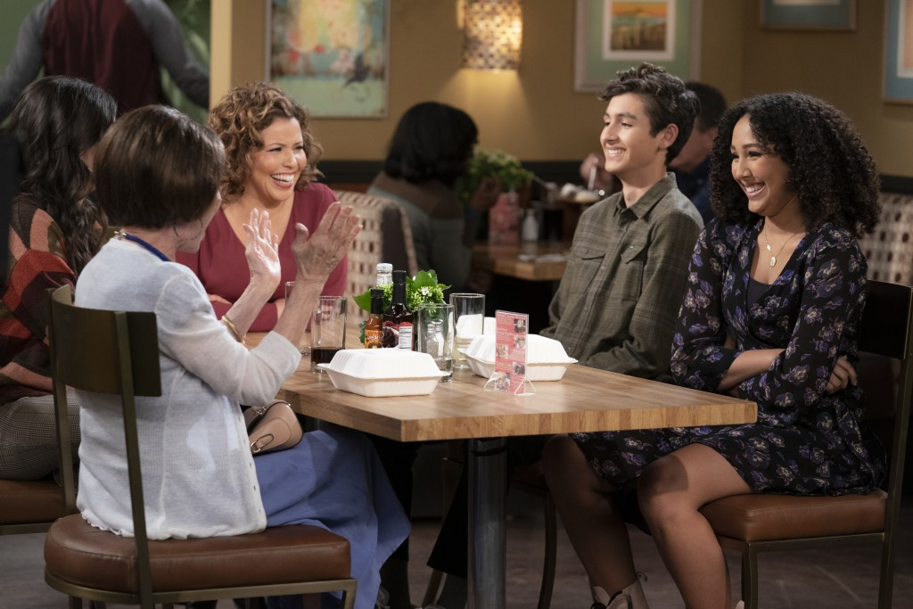 """(L-R): Rita Moreno as Lydia, Justina Machado as Penelope, Marcel Ruiz as Alex and Raquel Justice as Nora in """"Penny Pinching"""", ONE DAY AT A TIME.  Photo Credit: Nicole Wilder/POP TV."""