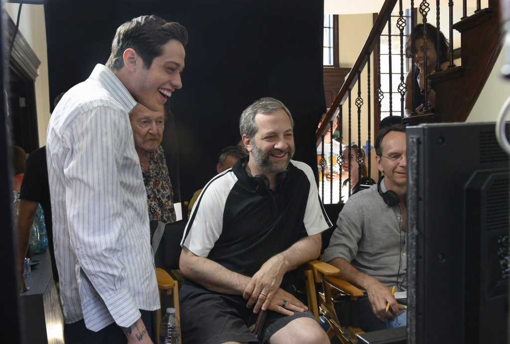 """(from left) Pete Davidson and director Judd Apatow with crew members on the set of """"The King of Staten Island."""""""