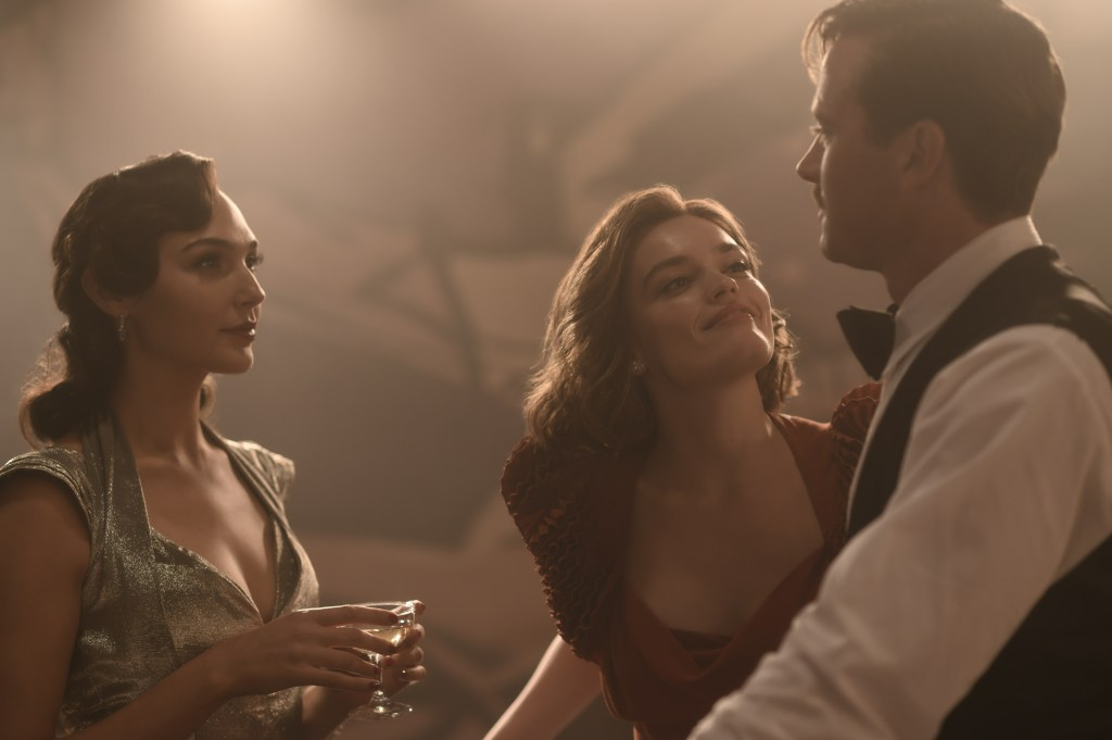 Gal Gadot as Linnet Ridgeway, Emma Mackey as Jacqueline De Bellefort and Armie Hammer as Simon Doyle in 20th Century Studios' DEATH ON THE NILE, a mystery-thriller directed by Kenneth Branagh based on Agatha Christie's 1937 novel. Photo by Rob Youngson. © 2020 Twentieth Century Fox Film Corporation. All Rights Reserved.
