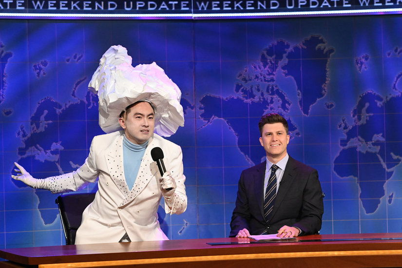 """SATURDAY NIGHT LIVE -- """"Carey Mulligan"""" Episode 1802 -- Pictured: (l-r) Bowen Yang as 'The Iceberg That Sank The Titanic' and anchor Colin Jost during Weekend Update on Saturday, April 10, 2021 -- (Photo by: Will Heath/NBC)"""