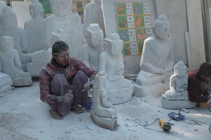 guy making statues