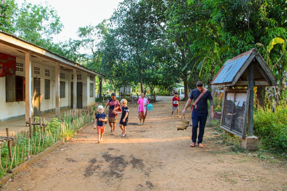 Walking through the village on our Laos homestay.