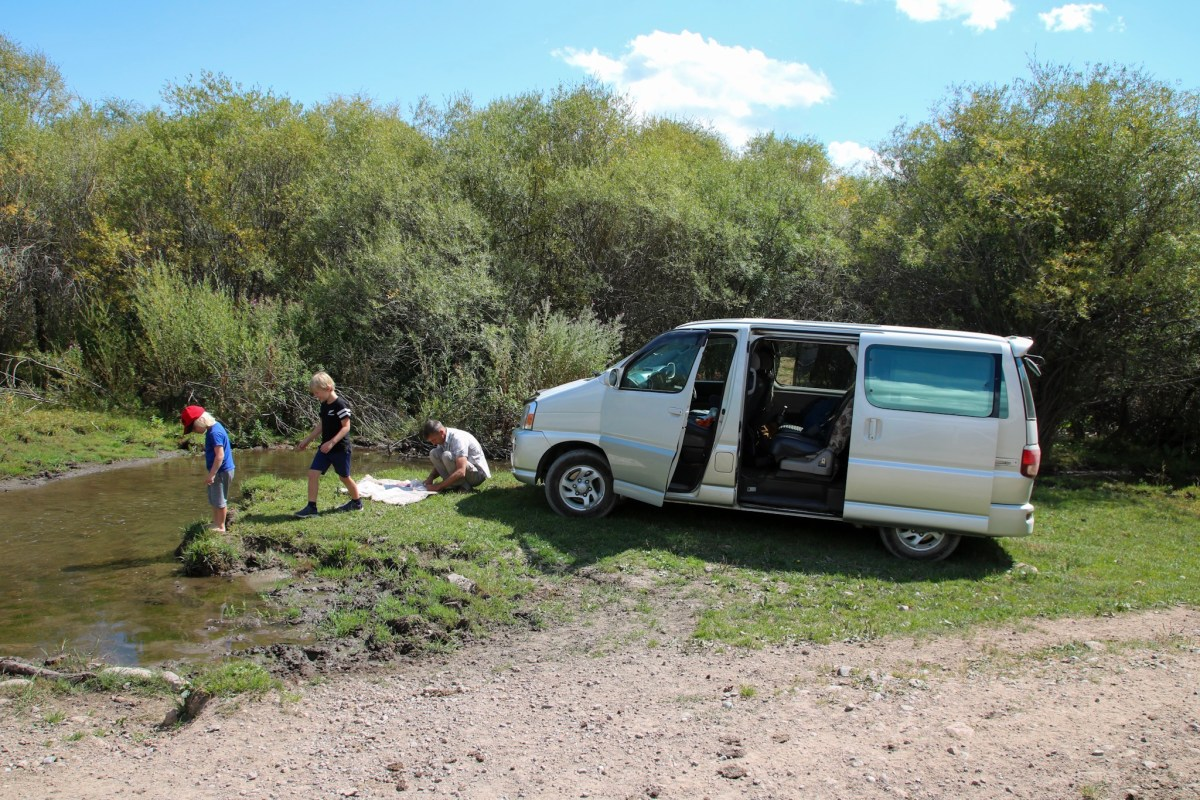 Setting off to cross the border from Kyrgyzstan into Kazakhstan with the kids.