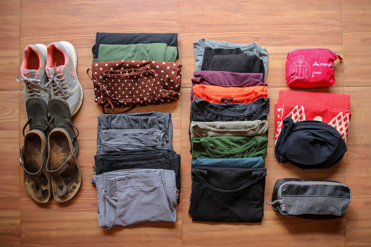 Clothes displayed from adult pack for longterm travel.