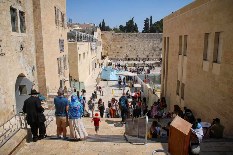 Family travel to Israel. Oscar leading the way down to the Western Wall.