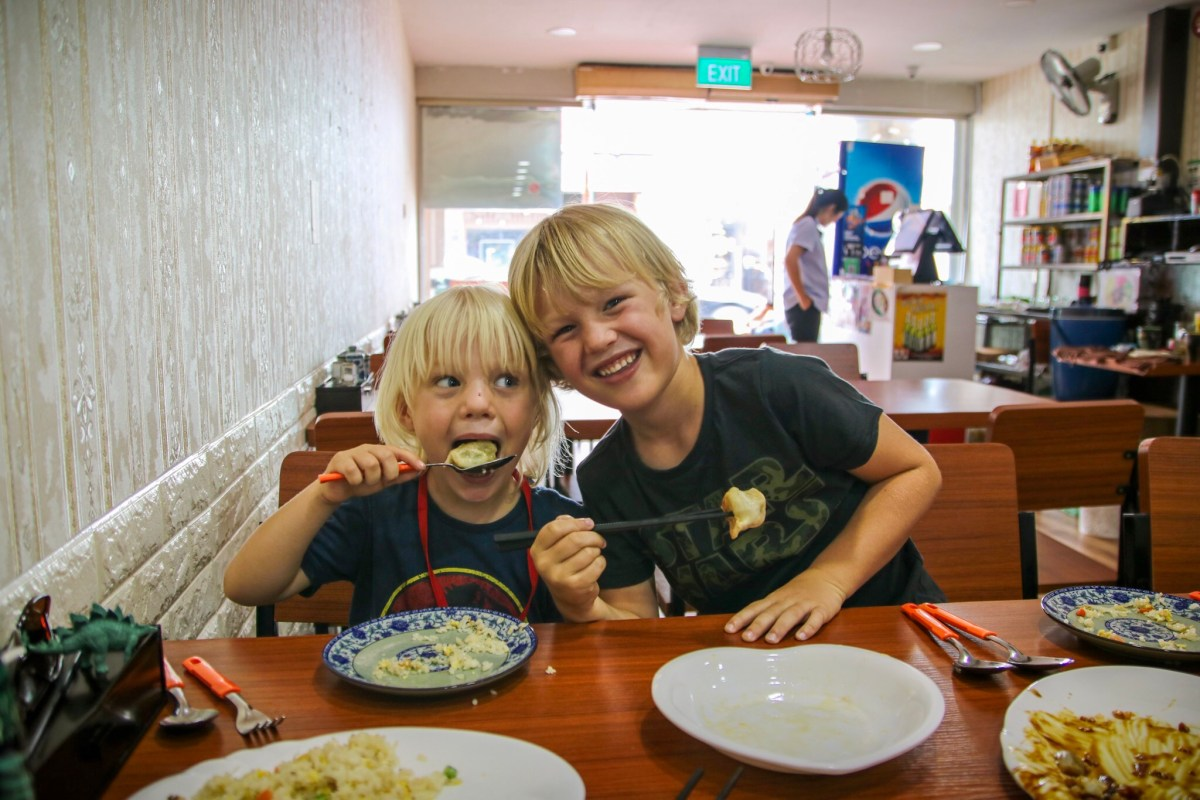 Out eating dumplings in Singapore with the kids.