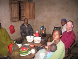 Sharing a meal with farmers in Bacho, Tanzania