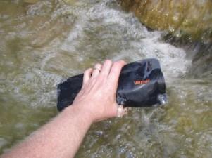 Filling the Vapur Anti-Bottle in a stream
