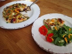 Serve the frittata with salad leaves including the  nasturtium leaves and flowers