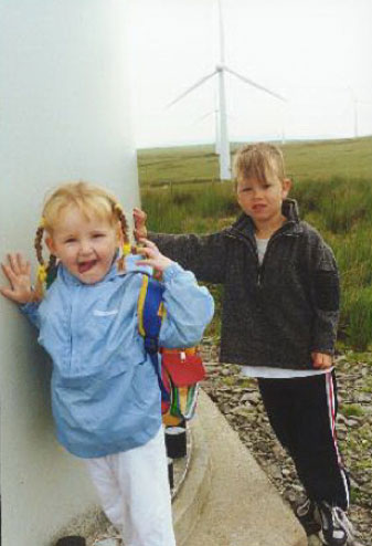 young children with wind turbines